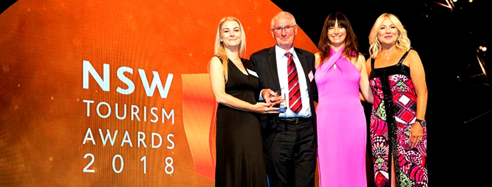 Riverside Holiday Resort Manager Rebecca Beaton beside FCWSC CEO Ken Conway at the 2018 NSW Tourism Awards