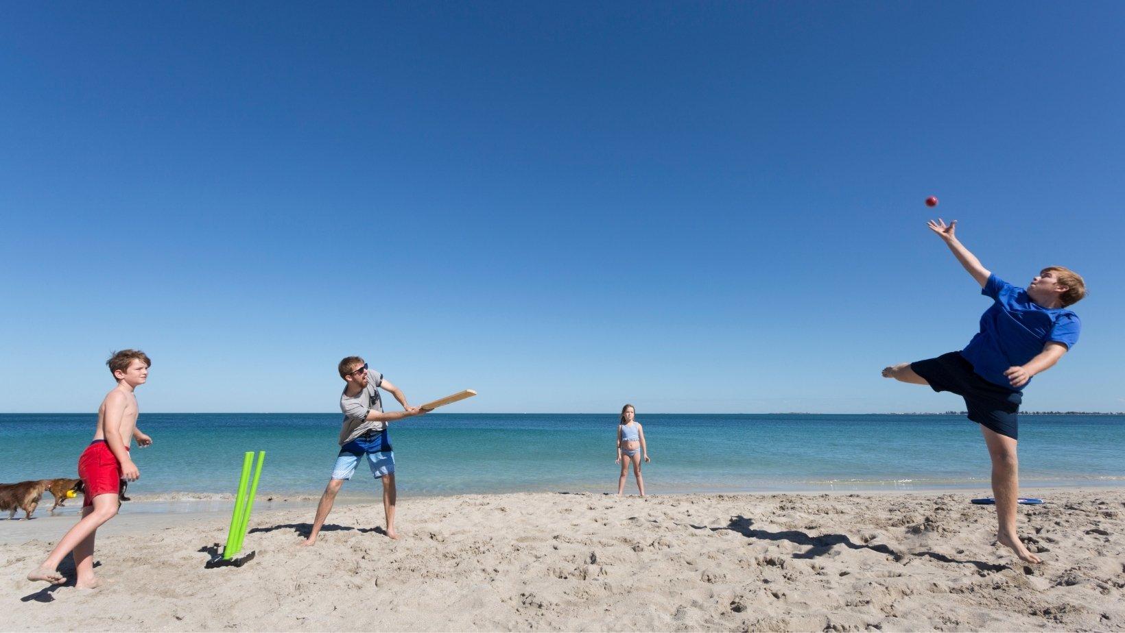 Backyard cricket on the beach, New South Wales, Australia